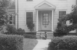 My brother and I sitting on the front porch of our house in Stamford, Connecticut, 1950